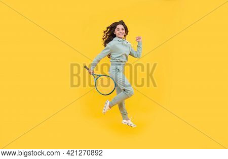 Happy Energetic Kid Jump In Sportswear With Squash Racquet Running To Success, Stamina.