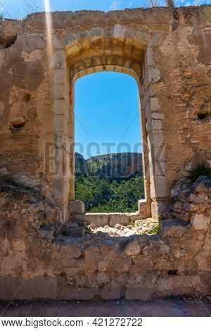 Window Of The Castle Of The Town Of Chulilla In The Mountains Of The Valencian Community. Spain