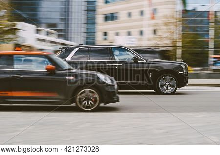 Black Suv Car Rolls-royce Cullinan At The City Street. 5-door Luxury Suv In Motion. Moscow, Russia -