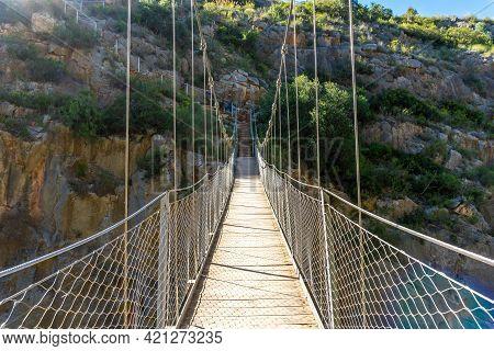 Wooden Suspension Bridges In The Loriguilla Reservoir. Ruta De Los Pantaneros In The Town Of Chulill