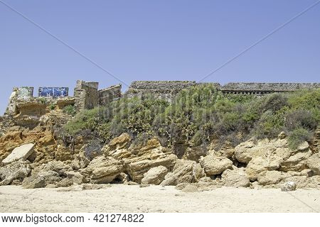 Remains Of A Wall Found On A Beach In The Port Of Santa Maria, Cadiz, Andalusia, Spain