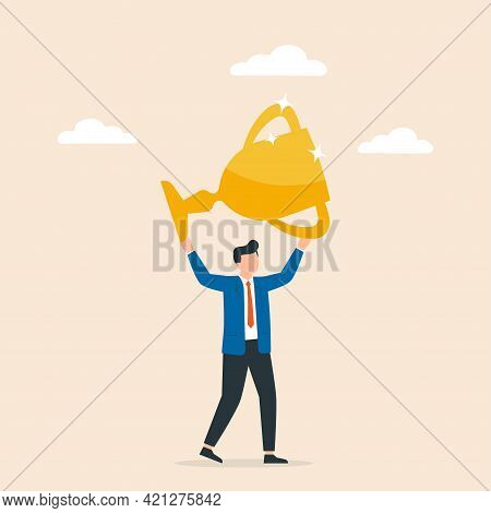 Business Man Holding Up Golden Cup Over Head. Concept Of Business Success, Triumph Or Victory Celebr