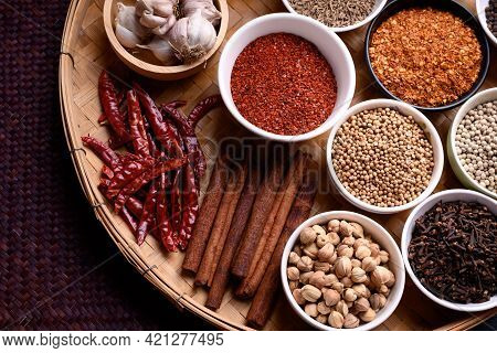 Various Dry Spices And Herbs In A Bowl On Bamboo Tray. Asian Food Ingredients (chili, Clove, Caraway