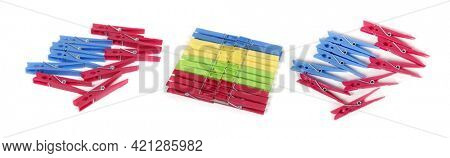 Colored clothespins on white background