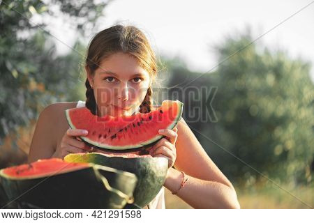 Portrait Of Happy Young Woman Enjoing And Eating Watermelon Outdoors, Slow Life. Summer Lifestyle Co