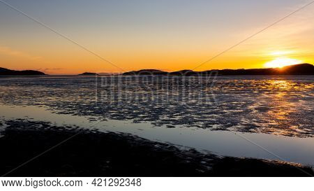 Golden Winter Sunset Over Kirkcudbright Bay Mudflats And The Dee Estuary At Low Tide, With Ross Isla