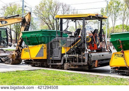 Samara, Russia - May 10, 2021: Volvo Asphalt Paver Machine On The Road Repair Site, Construction Mac