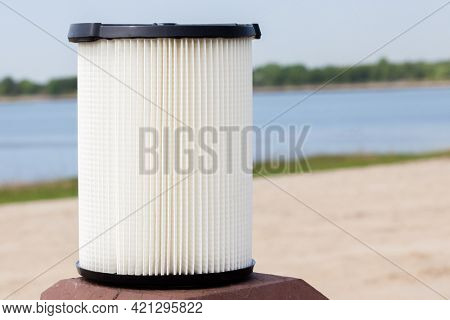 Vacuum filter with water in background