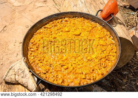Preparation Of The Embers Of The Valencian Paella With Embers And Vegetables. Traditional Spanish Fo