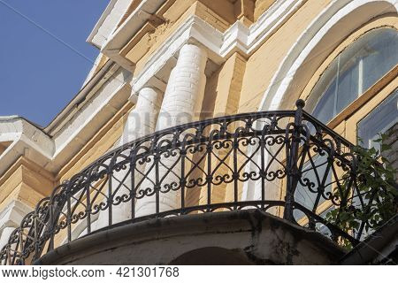 Balcony Of An Old House. Window And Wall Of An Old Building. Details Of Old Architecture