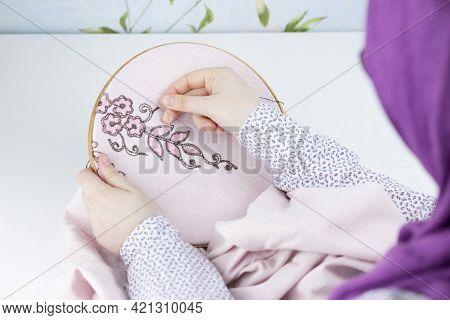 Hand Embroidery Flowers. Muslim Woman Hands Holding Hoop, Thread Mouline. Needlework.