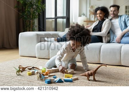 Happy Multiethnic Family With Kid Relax At Home