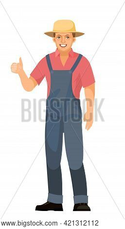 Farmer Guy Is Standing. Young Handsome Cute Boy Wearing A Hat. Shows Like. Luck, Quality. In Uniform