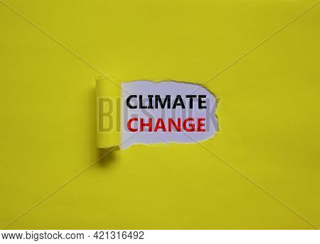 Climate Change Symbol. Words 'climate Change' Appearing Behind Torn Yellow Paper. Beautiful Yellow B