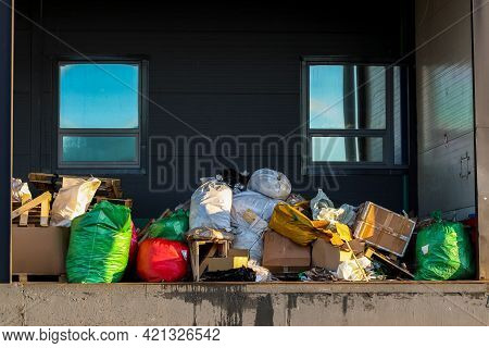 Packaged Waste For Landfilling. Garbage Bags And Boxes On The Loading Dock. Waste Removal.