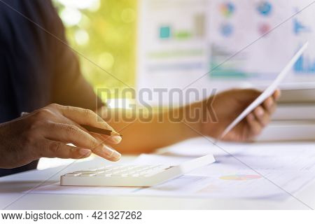 Accounting Businessmen Or Man Entrepreneurs Are Calculating Income Expenditure, Financial Data Repor