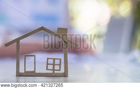 A Wooden House With A Blurred Background And Copy Space For Text. Mortgage Loading Real Estate Prope