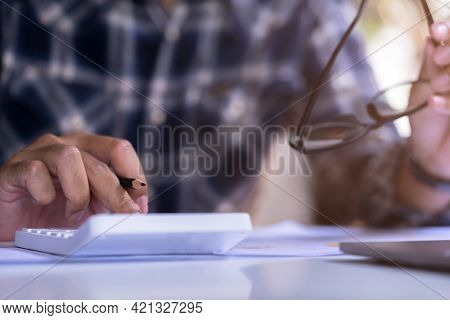Personal Finance Management, Accounting Concept. Businessman, Accountant Using Calculator To Calcula