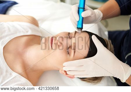 Woman Getting Facial Hydro Microdermabrasion Peeling Treatment At Spa Center. Hydra Vacuum Cleaner.