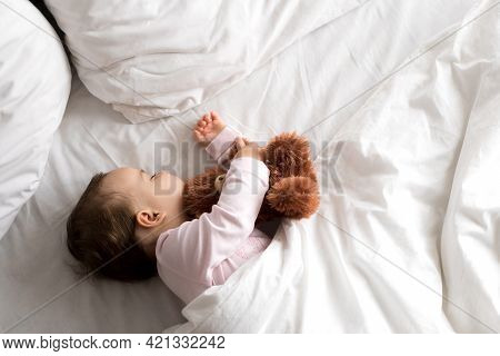 Authentic Portrait Cute Caucasian Little Infant Chubby Baby Girl Or Boy In Pink Sleep With Teddy Bea
