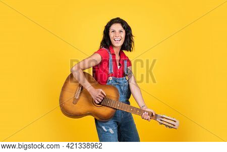 Teacher Of Music. Happy Beautiful Lady Playing The Guitar. Music And Vocal. Female Country Singer. C