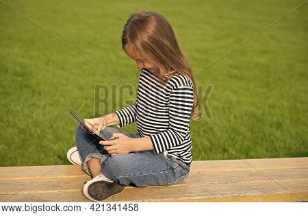 Digitally Yours. Little Child Use Tablet Sitting On Park Bench. Tablet Pc Technology. Modern Life. N