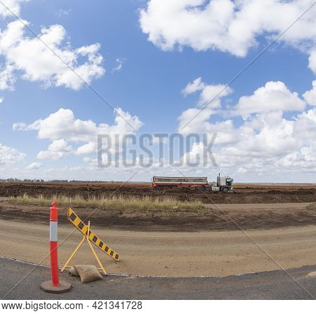 Clermont, Queensland, Australia - May 2021: A Bulk Haulage Truck Amongst Roadworks In A Country Land