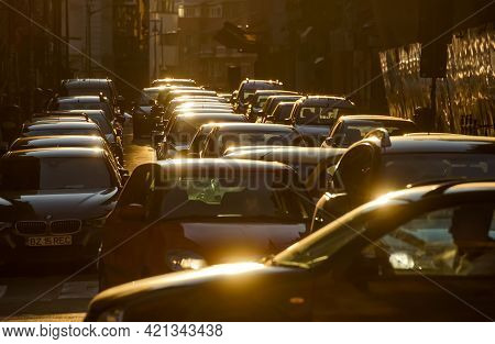 Bucharest, Romania - March 08, 2021: Cars In Traffic At Rush Hour On A Boulevard In Bucharest.