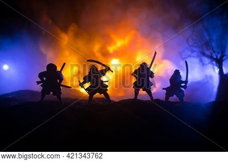 Samurai Fighting Concept. Silhouette Of Samurais In Duel Near Tree And Old Temple. Table Decoration