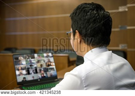 Online Meeting And Schooling, Close-up Office Man Use Computer Laptop For Online Meetings With Video