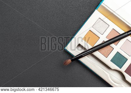 Makeup Palette With Brush On Black. Top View. Space For Text.