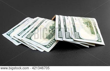 Dollar Bills On A Black Background. Close Up.