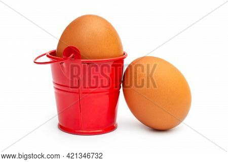 Chicken Egg In Small Bucket On White Background.