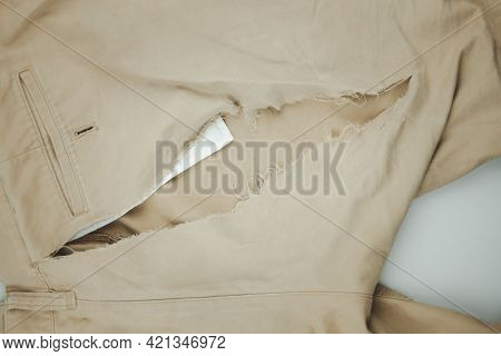 Man Cloth From Torn Clothes With A Hole. Top View