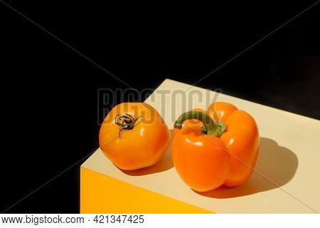 Creative Composition Made Of Orange Tomato And Bell Pepper On Geometric Colorful Background. Healthy