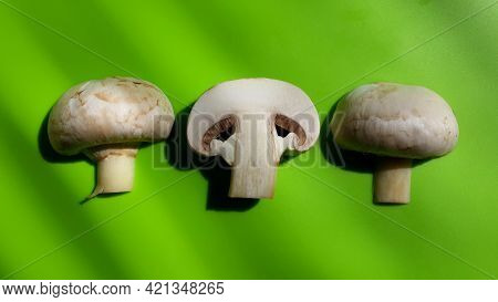Slices Fresh Mushroom Champignon On Green Background. Close-up Object. Top View.