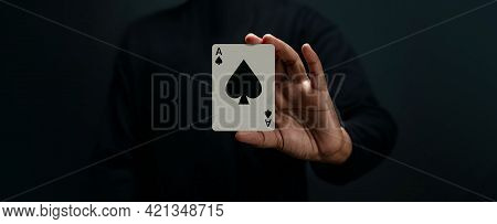 Ace Spade Playing Card. Player Or Magician Holding A Poker Card. Front View. Closeup And Dark Tone