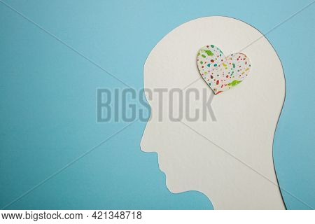 World Heart And Mental Health Day. Paper Cut As Human Head With Colorful Heart Inside The Brain. Psy