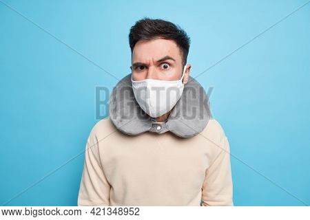 Indoor Shot Of Serious Attentive Man Wears Protective Mask Against Coronavirus Inflated Neck Pillow