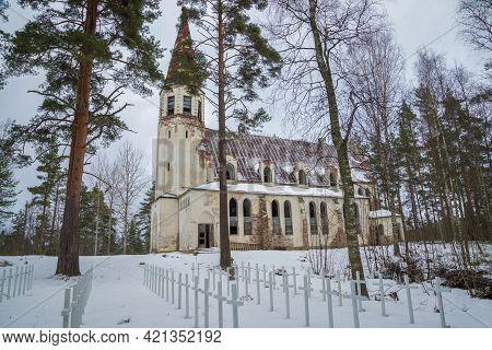 Finnish War Cemetery And The Abandoned Church Of Lumivaara On A Gloomy February Day. Karelia, Russia