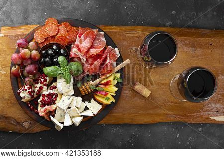 A Set Of Appetizers For Wine, Jamon, Pepperoni, Cheese, Grapes, Peach And Olives On A Wooden Board T