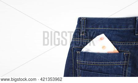 Menstrual Pad In Pocket Jeans. Woman Pad In The Pocket Of Female Jeans.