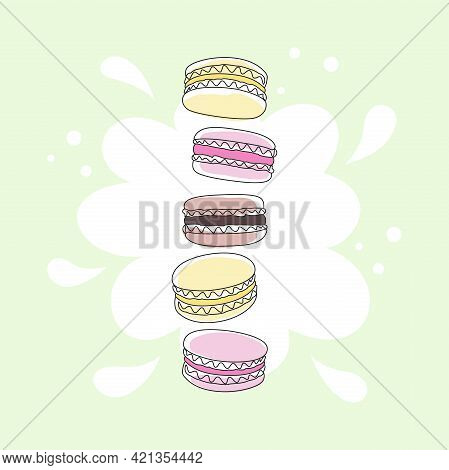 Abstract Colored Macaroons On A Light Green Background With A White Spot. French Sweet Pastries And