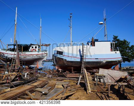 Small Traditional Classical Design Boat In A Shipyard For Renovations And Routine Maintenance - Mari