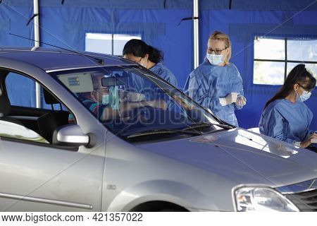 Bucharest, Romania - May 22, 2021: A Man Is Getting Covid-19 Vaccine In His Arm In His Car, In A Dri