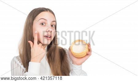 Happy Child Presenting Beauty Cosmetic Product Of Facial Skin Cream Isolated On White, Nourishing