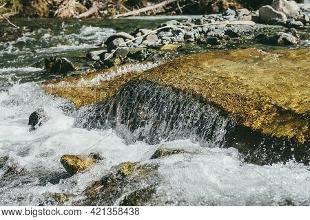 Colorful Nature Background With Big Boulder In Turbulent Flow Of Mountain River In Sunny Day. Water