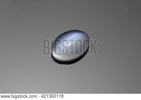 Natural Oval Cabochon Moonstone Feldspar Gem. Light Gray With Blue Shade And Cat's Eye Optical Effec