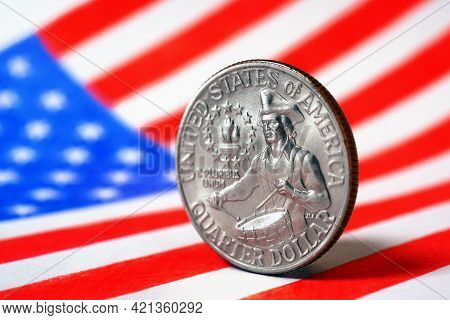 Us Quarter Dollar Coin With Drummer Close-up And Usa Flag. Stars And Stripes In The Blur. A Vivid Il