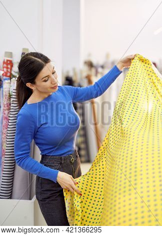 Tailor, Seamstress, Couture Or Dressmaker Concept. Young Brunette Female Dressmaker Or Seamstress Lo